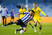 Sheffield Wednesday forward Atdhe Nuhiu (17) goes down under pressure from Swansea City midfielder George Byers (28)  during the EFL Sky Bet Championship match between Sheffield Wednesday and Swansea City at Hillsborough, Sheffield, England on 9 November 2019.