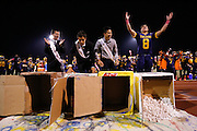 David Kruskamp (8), right, celebrates after being crowned Homecoming King during halftime activities during homecoming against Saratoga at Milpitas High School in Milpitas, California, on October 11, 2013.  Milpitas beat Saratoga 54-14. (Stan Olszewski/SOSKIphoto)