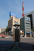 A traffic control station near Tokyo Tower with policemen. Tokyo, Japan. Saturday, May 9th 2009