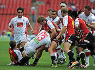 JOHANNESBURG, South Africa, 02 April 2011. Jaco Taute and Andre Pretorius of the Lions try to bring Digby Ioane of the Reds to ground during the Super15 Rugby match between the Lions and the Reds at Coca-Cola Park in Johannesburg, South Africa on 02 April 2011. .Photographer : Anton de Villiers / SPORTZPICS