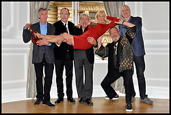 L to R Michael Palin, Eric Idle, Terry Jones,Terry Gilliam,  John Cleese pose for photographers with Carol Cleveland at the <br /> Photocall for the Monty Python reunion. London, United Kingdom. Thursday, 21st November 2013. Picture by Andrew Parsons / i-Images