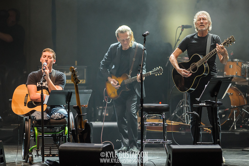 WASHINGTON, DC - October 16th, 2015 - Roger Waters (right) performs with Marine Lance Cpl. Tim Donnelly Tim Donnelly and G.E. Smith at the Music Heals benefit concert at DAR Constitution Hall in Washington, D.C. The concert benefits Music Corps, an organization that helps injured veterans play music and adjust to postwar life. (Photo by Kyle Gustafson / For The Washington Post)