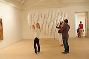 photographing art works, Gallerygoers viewing the Indonesian Eye Contemporary Art Exhibition, Saatchi Gallery. London. Saturday 10 September 2011. <br /> <br />  , -DO NOT ARCHIVE-&copy; Copyright Photograph by Dafydd Jones. 248 Clapham Rd. London SW9 0PZ. Tel 0207 820 0771. www.dafjones.com.