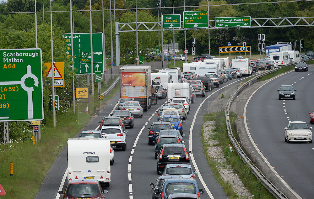 © Licensed to London News Pictures. 28/05/2016. York, UK.  Bank Holiday weekend traffic builds up on the A64 Leeds to Scarborough road near York.  Photo credit: Anna Gowthorpe/LNP