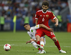 June 24, 2017 - Kazan, Russia - Georgy Dzhikya (R) of Russia national team and Javier Hernandez of Mexico national team vie for the ball during the Group A - FIFA Confederations Cup Russia 2017 match between Russia and Mexico at Kazan Arena on June 24, 2017 in Kazan, Russia. (Credit Image: © Mike Kireev/NurPhoto via ZUMA Press)