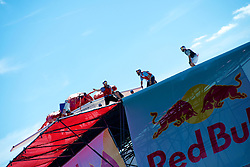 """Red Bull Flugtag, Camden Waterfront, NJ USA - September 15, 2012;.33 teams compete in the second edition of the Philly Red Bull Flug Tag. Thousands came out on both sides of the river to see handmade crafts attempt to fly. Team """"New Kids on the Dock"""" from Philadelphia, PA took the 1st prize for covered distance...Team """"New Kids on the Dock"""" performs their sketch on the flight deck before heading for the depth and in their case distance.."""