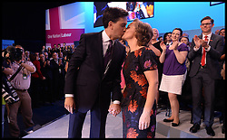 Ed Miliband kisses his wife Justine after Keynote Speech. <br /> Labour leader Ed Miliband and his wife Justine Thornton arriving to the Brighton Conference centre before delivering his Keynote speech to the Labour Party Conference delegates at the Brighton Conference Centre, Brighton, United Kingdom. Tuesday, 24th September 2013. Picture by Andrew Parsons / i-Images