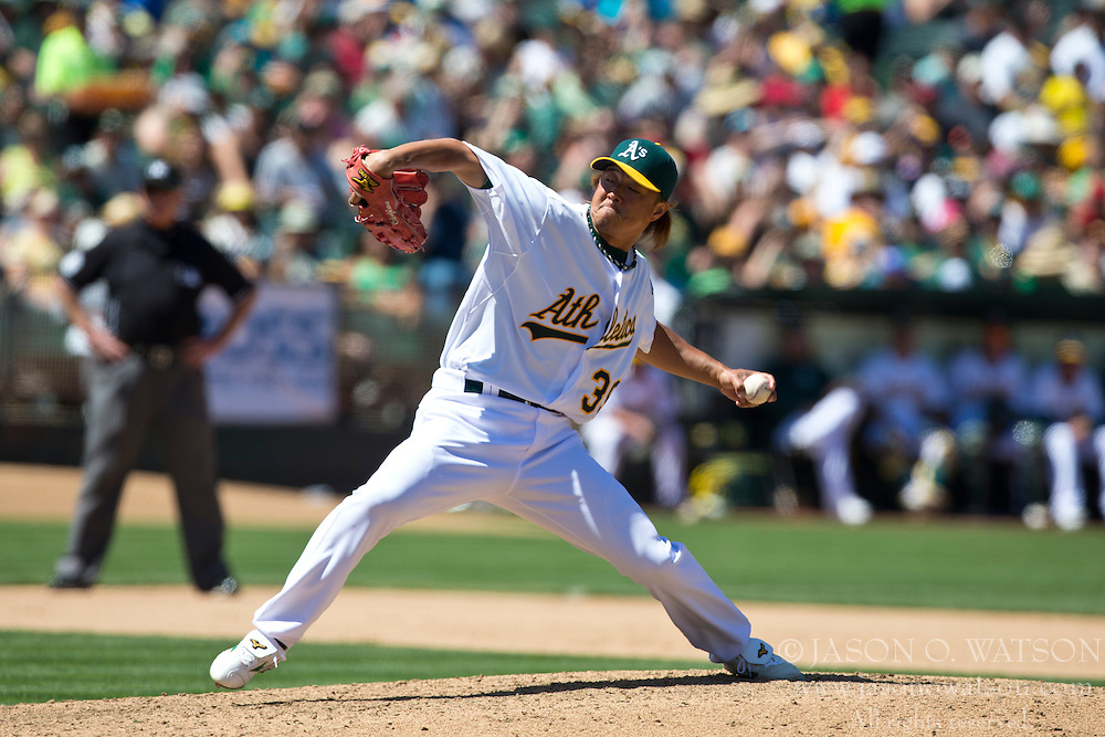 OAKLAND, CA - MAY 19: Hideki Okajima #39 of the Oakland Athletics pitches against the Kansas City Royals during the seventh inning at O.co Coliseum on May 19, 2013 in Oakland, California. The Oakland Athletics defeated the Kansas City Royals 4-3. (Photo by Jason O. Watson/Getty Images) *** Local Caption *** Hideki Okajima