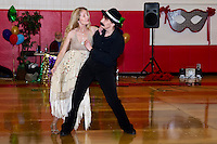 Robin Barnes from Broadway North and partner Janice Jenkett from Jazzercise have some fun with their steamy dance routine for Dancing With the Community Stars competition Saturday evening at Laconia Middle School.  (Karen Bobotas/for the Laconia Daily Sun)