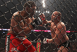 Feb 12, 2011; East Rutherford, NJ; USA; Fedor Emelianenko (black trunks) and Antonio Silva (red trunks) fight during their opening round bout of the Strikeforce Heavyweight Grand Prix at the IZOD Center in East Rutherford, NJ.  Silva won via doctor stoppage at the end of the second round.