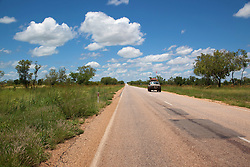 A lone tourist vehicle on the road from Derby to Fitzroy Crossing  in the wet season.