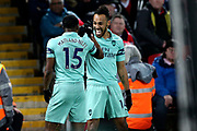 Arsenal celebrate Arsenal midfielder Ainsley Maitland-Niles (15) goal 0-1 during the Premier League match between Liverpool and Arsenal at Anfield, Liverpool, England on 29 December 2018.