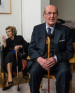 "Movie director Manoel de Oliveira and his wife, in the ceremony where he receives de distinction of ""Grand Officier de la Légion d'Honneur"" by the French Ambassador in Portugal, Jean-François Blarel"