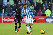 Huddersfield Town midfielder Elias Kachunga (9) in action during the Premier League match between Huddersfield Town and Arsenal at the John Smiths Stadium, Huddersfield, England on 9 February 2019.