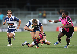 Tim Whitehead of the DHL Stormers slips through a tackle during the final warm-up match before the start of the Super Rugby season between the DHL Stormers and the Boland Cavaliers held at DHL Newlands Stadium in Cape Town, South Africa on 12 February 2011. Photo by Jacques Rossouw/SPORTZPICS