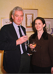 MR ROBIN LANGTON and the HON.MRS ROSAMOND KINDERSLEY, at a party in London on 7th May 1998.MHK 2