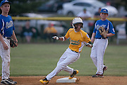 Erial's Cross Sarne looks at the catcher as he steals second on a past ball during a Section 4 Little League final against Cherry Hill held in Gloucester Sunday night.