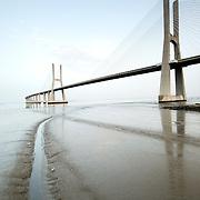 North towers of Vasco da Gama bridge on low tide