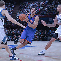 06 October 2010: New York Knicks guard Landry Fields #6 drives past Minnesota Timberwolves forward Michael Beasley #8 and Minnesota Timberwolves guard Luke Ridnour #13 during the Minnesota Timberwolves 106-100 victory over the New York Knicks, during 2010 NBA Europe Live, at the POPB Arena in Paris, France.
