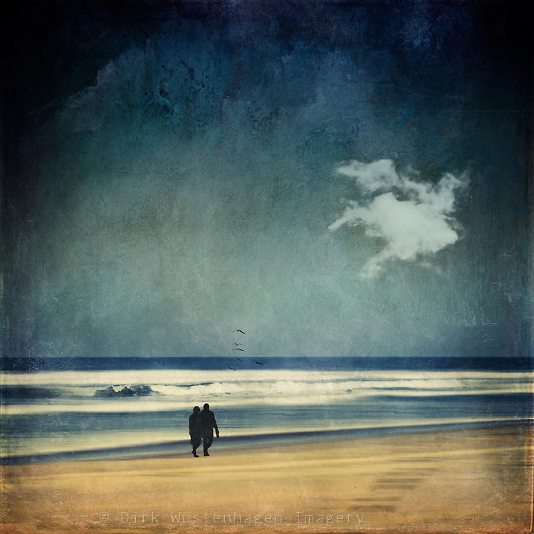 Couple walking on a beach<br />