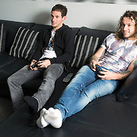 Raith Rovers v St Johnstone Cup Preview....07.03.14<br /> Former teammates and still housemates Stevie May and Kevin Moon pictured relaxing in Kevin's home where Stevie is the lodger ahead of tomorrow's cup tie. Everything is a competition between the two friends from darts to playstation<br /> Picture by Graeme Hart.<br /> Copyright Perthshire Picture Agency<br /> Tel: 01738 623350  Mobile: 07990 594431