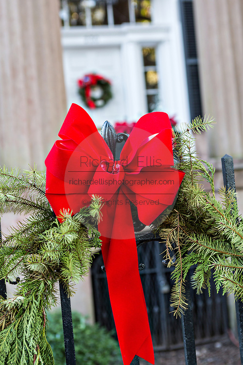 A Christmas bow decorates the front of the Harper Fowlkes House in historic Savannah, GA.