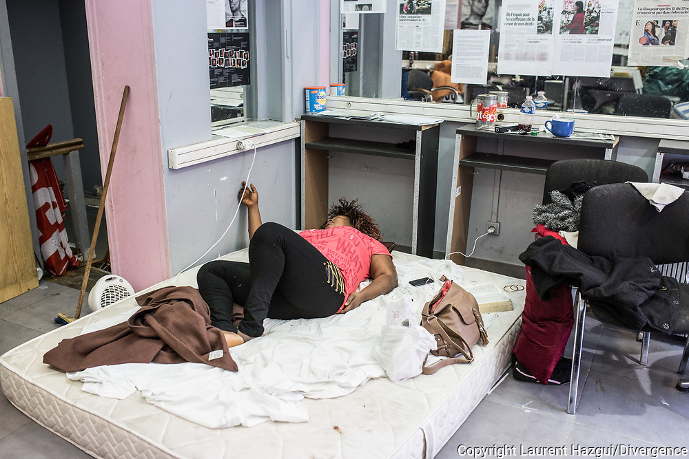 MARCH 2015. PARIS Picket line at the Barber shop where the strikers occupied the place. PRECIOUS IS SLLEPING LIKE THE OTHER STRIKERS SOME NIGHT FOR KEEPING THE PLACE.