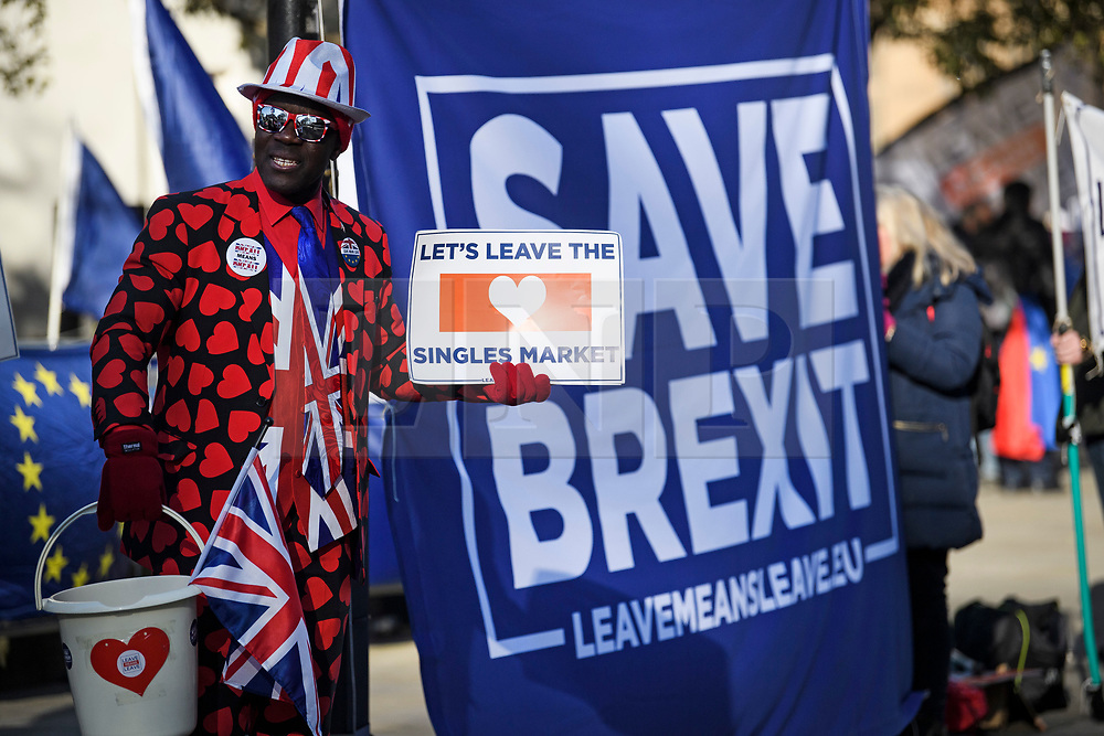 © Licensed to London News Pictures. 14/02/2019. London, UK. Pro Brexit campaigners outside the Houses of Parliament in Westminster, on the day that MPs are due to take part in further debates and votes on Brexit. A series of amendments are being tabled to try to change the direction of Brexit, but a vote on a deal will not be held today as was originally planned. Photo credit: Ben Cawthra/LNP