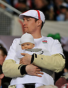 Supporter with baby at the England v Argentina  RWC Pool B match Played at the Otago Stadium on Saturday 10th September - Otago Stadium, Friday 9th September 2011 ~ Photo : Steven Hight (AURA Images)