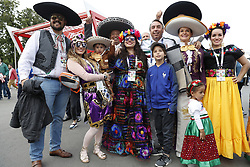 fans of Mexico wearing traditional clothing