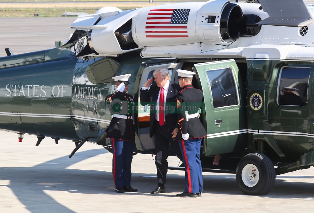 May 27, 2017 - Sigonella, Sicily, Italy - U.S. President Donald Trump salutes as he arrives by helicopter to addresses service members at Naval Air Station Sigonella before returning home from his nine-day overseas trip May 27, 2017 in Sigonella, Italy. (Credit Image: © Samuel Guerra/Planet Pix via ZUMA Wire)