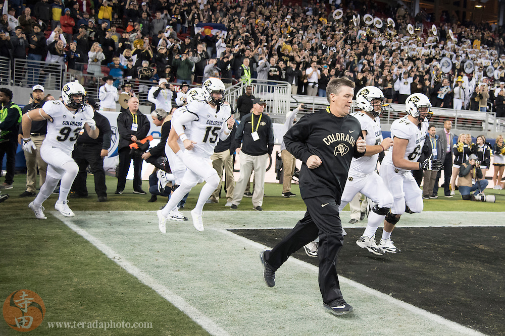 December 2, 2016; Santa Clara, CA, USA; Colorado Buffaloes head coach Mike MacIntyre runs onto the field before the Pac-12 championship against the Washington Huskies at Levi's Stadium. The Huskies defeated the Buffaloes 41-10.