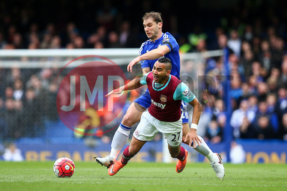 Dimitri Payet of West Ham United is tackled by Branislav Ivanovic of Chelsea - Mandatory byline: Jason Brown/JMP - 19/03/2016 - FOOTBALL - London, Stamford Bridge - Chelsea v West Ham United - Barclays Premier League
