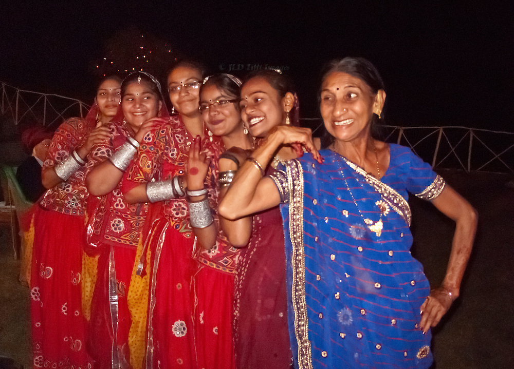 Six women dancers in traditional Gujarati costume pose after their performance at a dinner party near Bhuj.