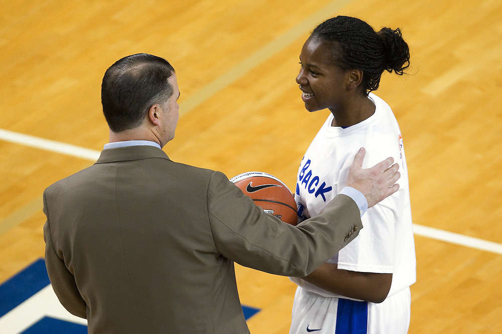 UK head coach Matthew Mitchell, left, presets center DeNesha Stallworth with a game ball before the game. Stallworth hit the 1,000 point mark. The University of Kentucky Women hosted Mississippi State University Thursday, Jan. 17, 2013 at Memorial Coliseum in Lexington. Photo by Jonathan Palmer
