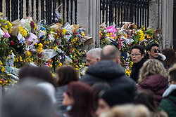 © Licensed to London News Pictures . 27/03/2017 . London , UK . Flowers and tributes fixed to railings outside Parliament in Westminster , in response to Khalid Masood's terrorist attack and the killing of PC Keith Palmer . Photo credit: Joel Goodman/LNP