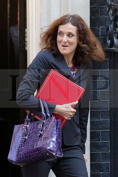 "© Licensed to London News Pictures. 29/08/2013. London, UK. Northern Ireland Secretary Theresa Villiers leaves a meeting of the British cabinet on Downing Street in London today (29/08/2013) as a recalled British Parliament prepares to debate the possibility of ""direct"" military action over recent reports an alleged chemical weapons attack in Syria. Photo credit: Matt Cetti-Roberts/LNP"