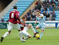 Photo: Kevin Poolman.<br />Coventry City v Burnley. Coca Cola Championship. 25/02/2006. Coventry's Dennis Wise (R) gets caught by Chris McCann.
