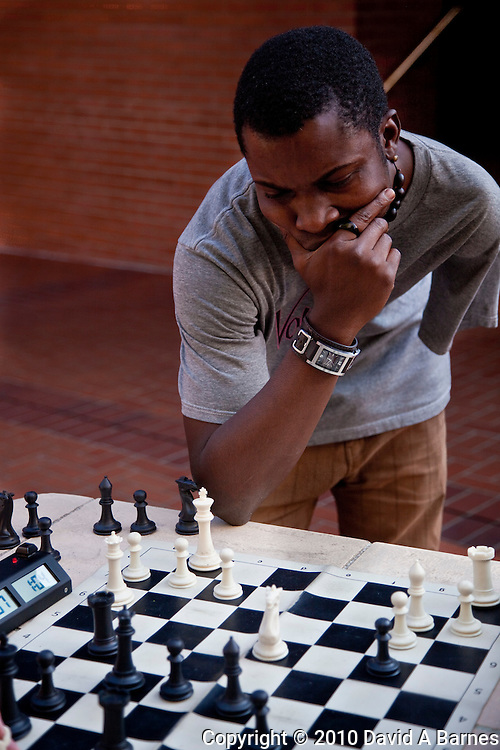 Chess player concentrating on next move