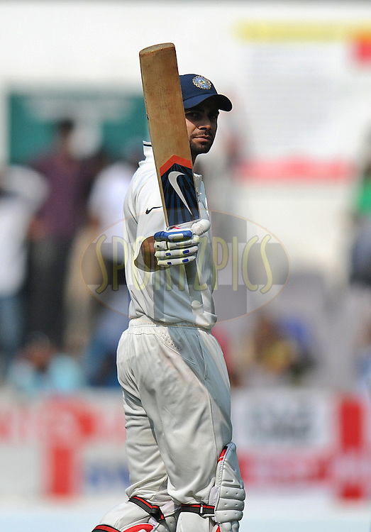 Virat Kohli of India raises his bat after scoring a half century during day three of the 4th Airtel Test Match between India and England held at VCA ground in Nagpur on the 15th December 2012..Photo by  Pal Pillai/BCCI/SPORTZPICS .