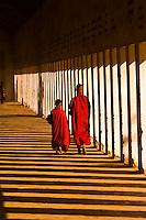 Two novice monks walking down a corridor in the Shwezigon Pagoda, Bagan (Pagan), Burma (Myanmar)
