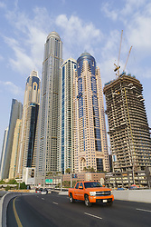 Street and modern skyscrapers in Marina District  in Dubai United Arab Emirates