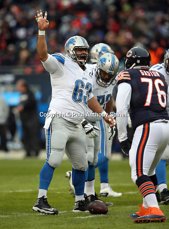 Detroit Lions guard Manny Ramirez (63) holds up his arm during the NFL week 17 regular season football game against the Chicago Bears on Sunday, Jan. 3, 2016 in Chicago. The Lions won the game 24-20. (©Paul Anthony Spinelli)