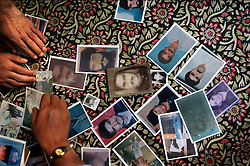 KASHMIR,INDIA, JULY 30:   Photos of missing Kashmiris are spread on the floor during a meeting of the Association of Parents of Disappeared Persons (APDP) in Srinagar, the Indian held summer capital of the state of Jammu and Kashmir July 30, 2003.  The group says that 8,000 people are missing since the insurgency began and they beleive most have been taken by Indian security forces and never returned.  Since 1989, Kashmir has been a state under siege, with both India and Pakistan laying claim to it. Human rights organizations say more than 80,000 have died in the 13 year old conflict. The Indian government says 40,000, but whatever the number, it has been mainly Kashmiri residents who have suffered as the two nuclear armed countries fight a proxy war.