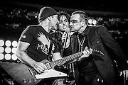 "The Edge of U2, Billie Joe Armstrong of Green Day and Bono of U2 perform ""The Saints Are Coming"" in a pre-game concert with Green Day prior to the Monday Night Football game between the Atlanta Falcons and New Orleans Saints as part of the re-opening of the Superdome in New Orleans, Louisiana on September 25, 2006."