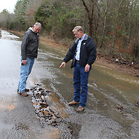 Monroe County Road Manager Sonny Clay, right, shows District 2 Supervisor Billy Kirkpatrick a section of Weaver Creek Road that sustained flood damage. The road was one of several impassable last week due to excessive rain.
