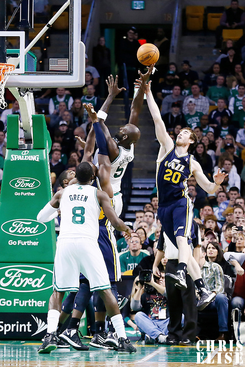 14 November 2012: Boston Celtics power forward Kevin Garnett (5) is fouled by Utah Jazz shooting guard Gordon Hayward (20) during the Boston Celtics 98-93 victory over the Utah Jazz at the TD Garden, Boston, Massachusetts, USA.