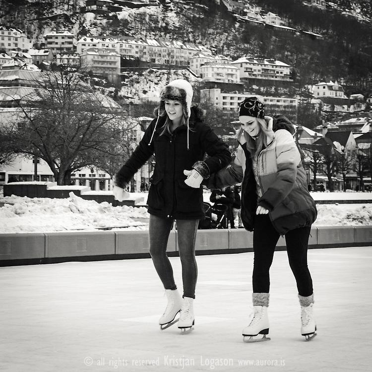 Girls iceskating on Lake lille Lungegardsvatnet in Bergen Norway