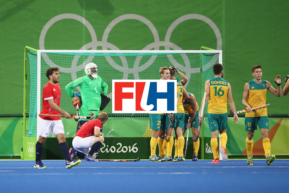 RIO DE JANEIRO, BRAZIL - AUGUST 10:  The Great Britain players look dejected as Australia celebrate their second goal during the men's pool A match between Great Britain and Australia on Day 5 of the Rio 2016 Olympic Games at the Olympic Hockey Centre on August 10, 2016 in Rio de Janeiro, Brazil.  (Photo by Mark Kolbe/Getty Images)