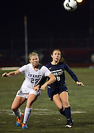 CB East's Paige Weiss #25 and Cedar Cliff's Ashley Hoagland #9 chase after a loose ball in the first half Tuesday November 10, 2015 in Doylestown, Pennsylvania.  (Photo by William Thomas Cain)